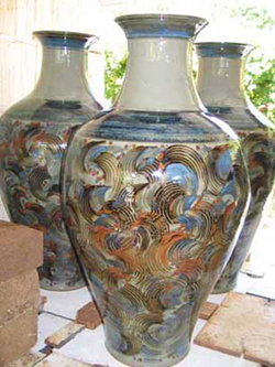 003 gallery, large floor jars coming out of the kiln