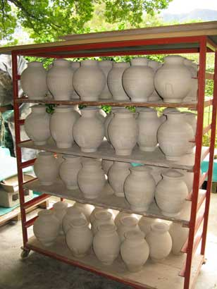 Tea Canisters for Nigiro Tea Merchants Tea Canisters drying outside.