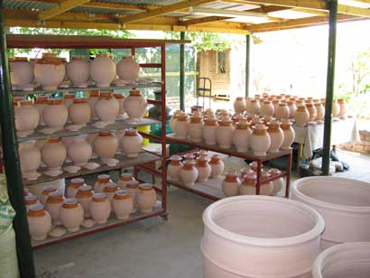 Tea Canisters for Nigiro Tea Merchants Nigiro tea canisters glaze, waxed & ready for their glaze firing.