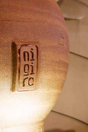 Tea Canisters for Nigiro Tea Merchants Close up of a Nigiro Tea Canister showing the logo.