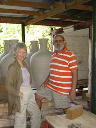 david  & felicity at kiln packed with large wine jars