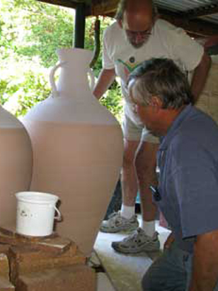 david & myburgh loading large wine jars for glaze firing